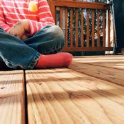 Picture of Child Sitting on Deck 2