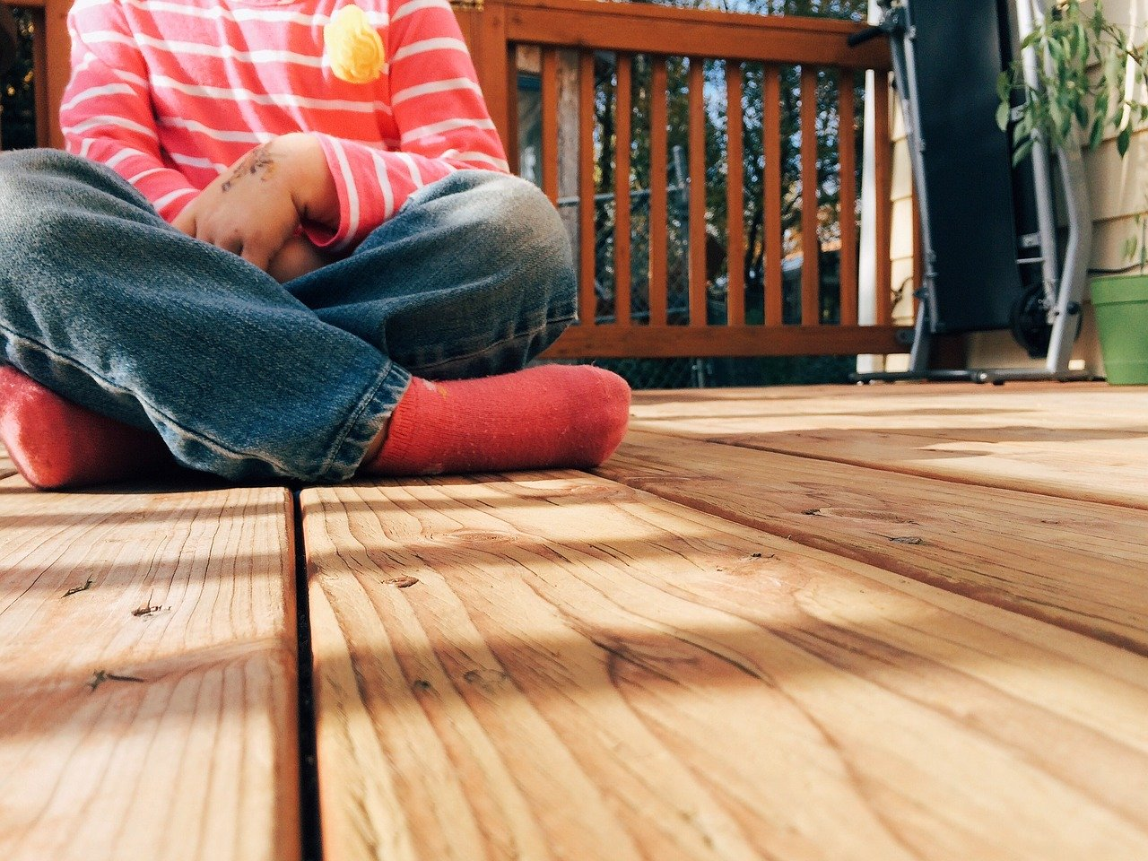 Picture of Child Sitting on Deck